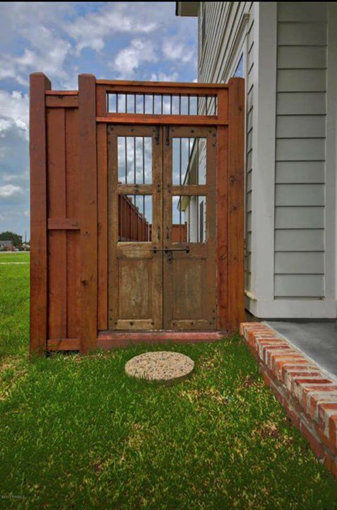 Custom fences with antique prison door gates from Breaux's Construction at  #tec…